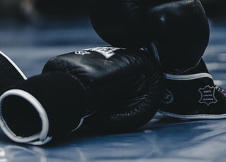 pair of black boxing gloves