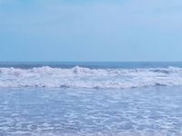 sea waves under clear blue sky