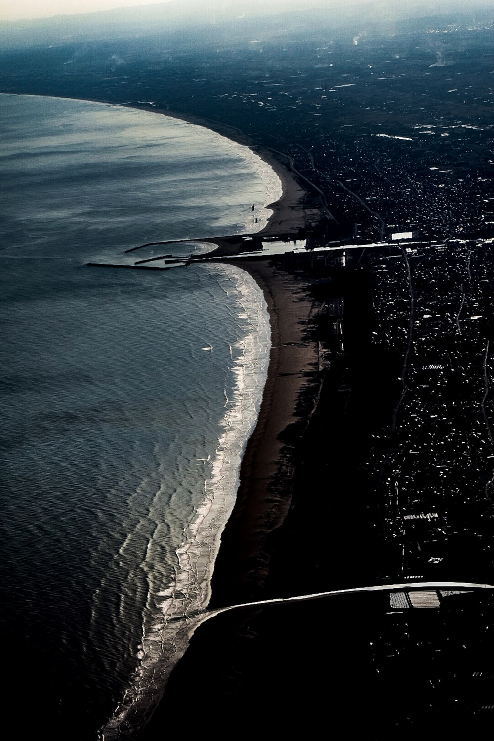 aerial photography of urban city near beach during daytime