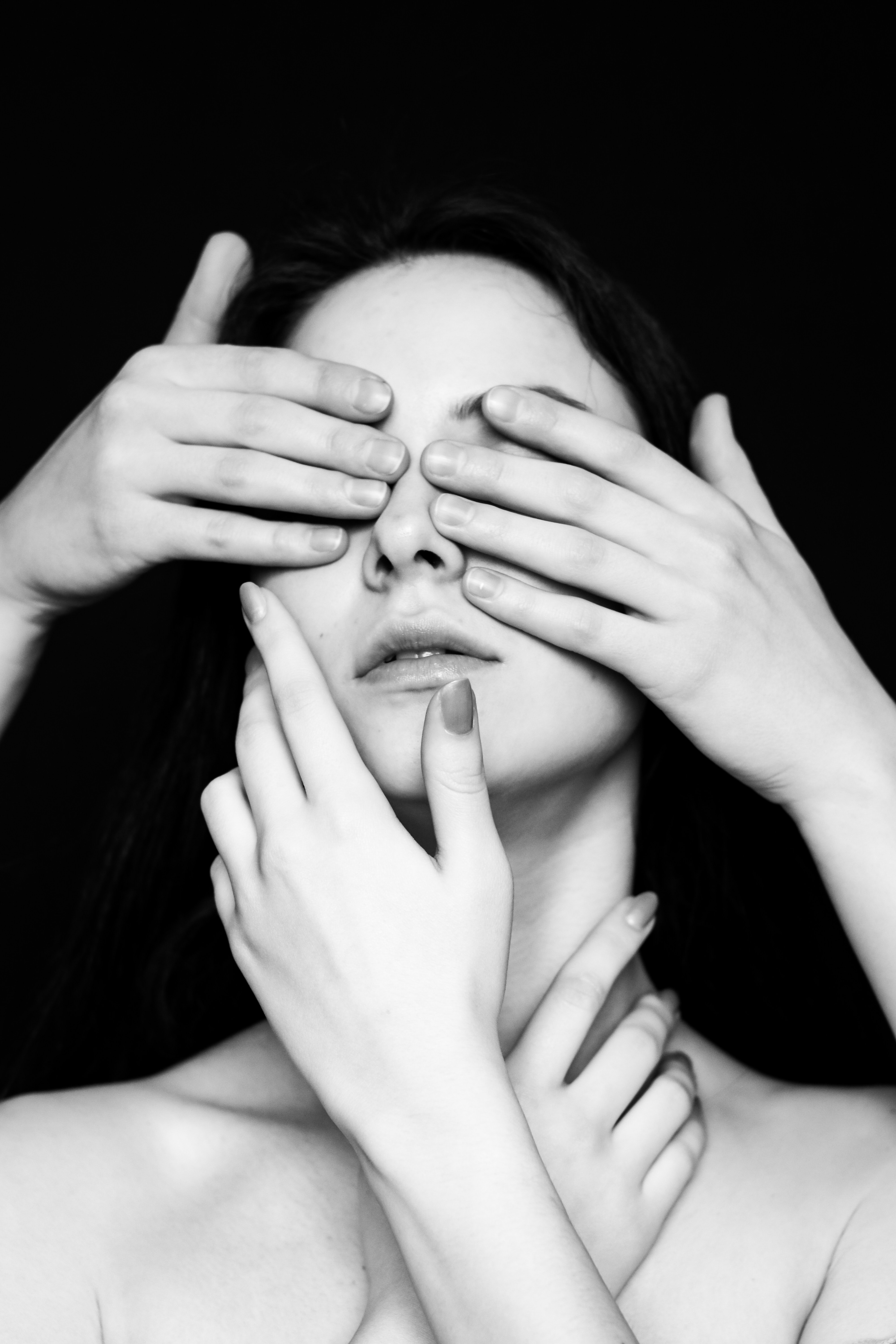 grayscale photography of woman covering eyes with hands