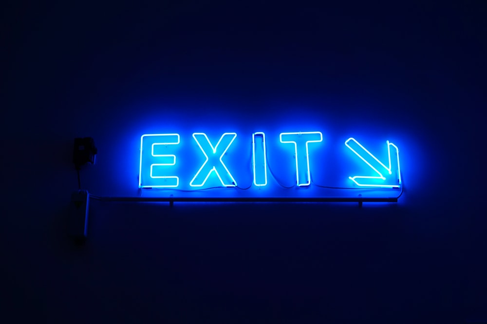 exit neon light signage