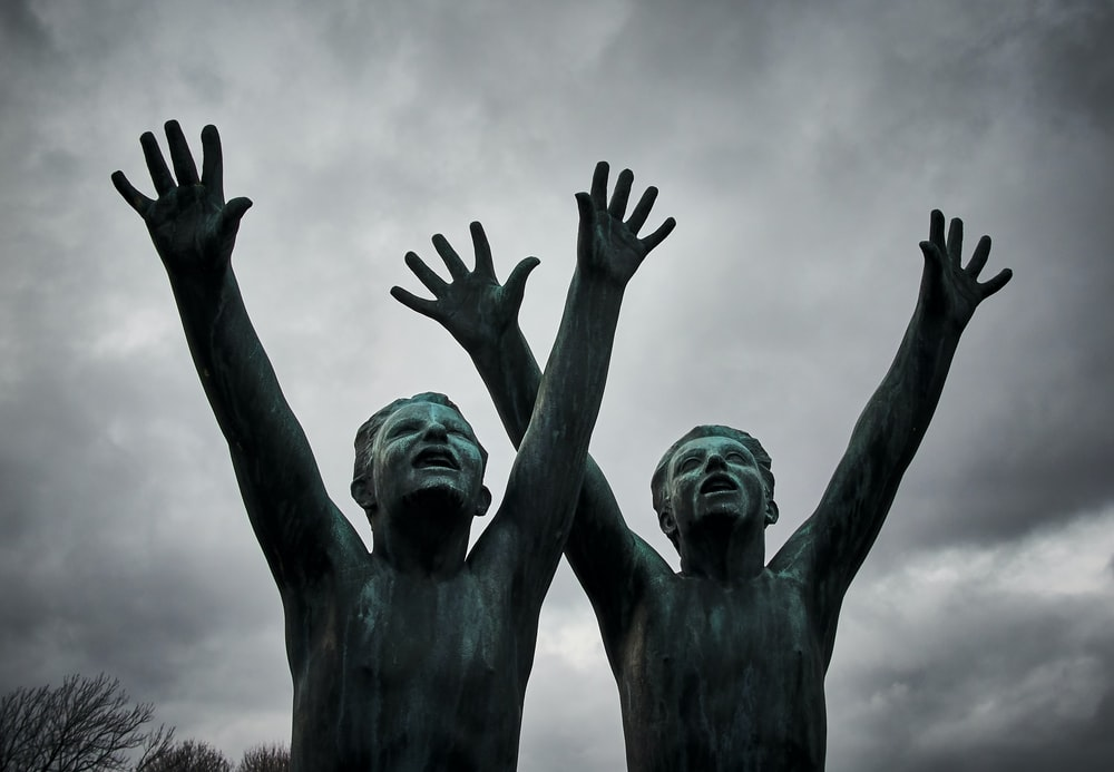 two man raising their hands