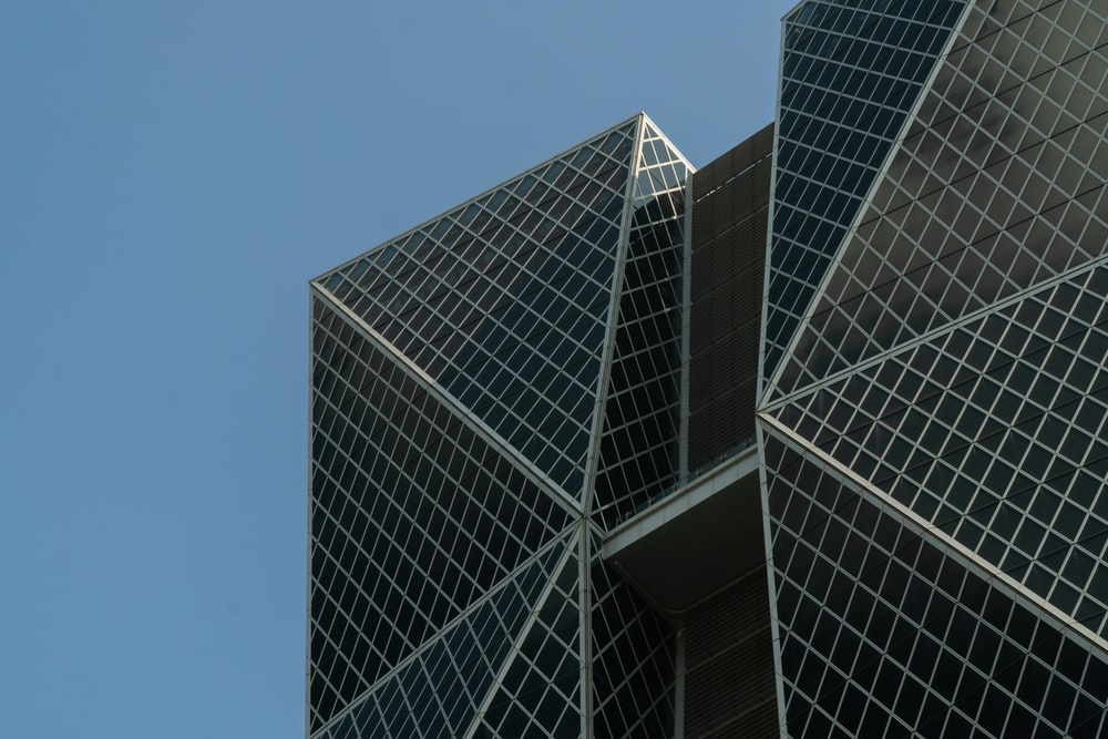 concrete glass curtain building during daytime