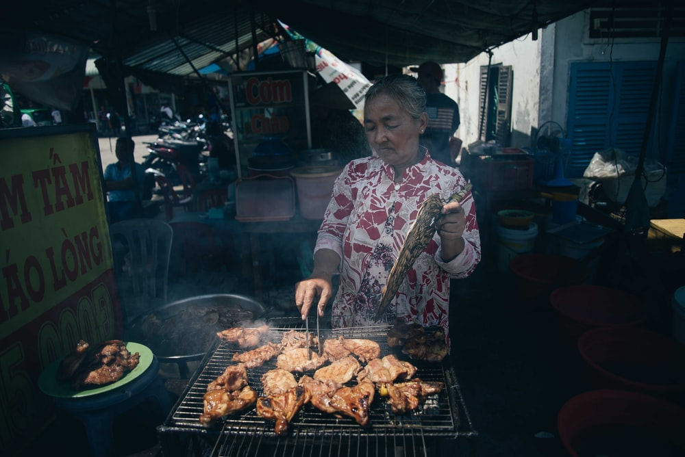 woman grilling chicken