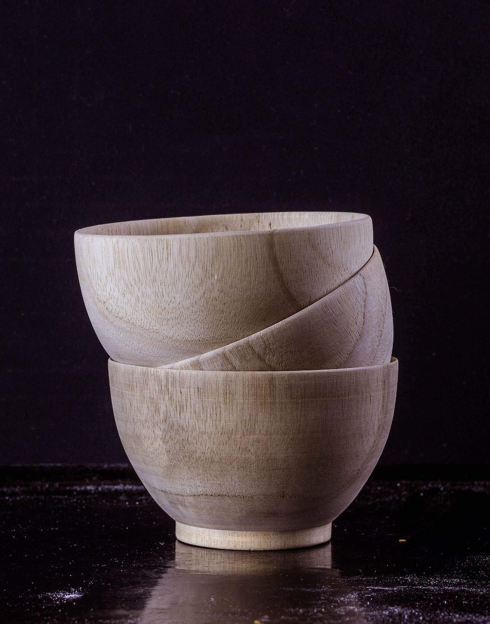 three brown ceramic bowl