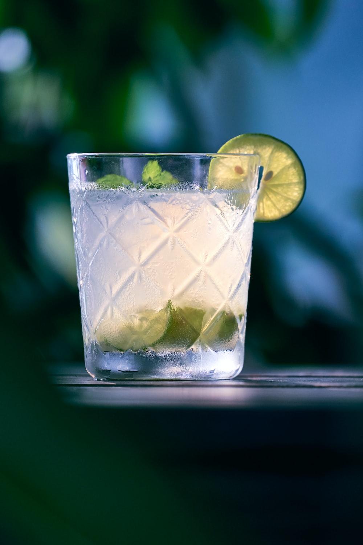 clear liquid inside clear drinking glass
