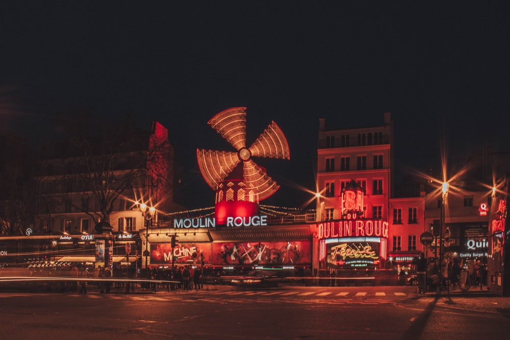 Moulin Rouge building beside road during nighttime