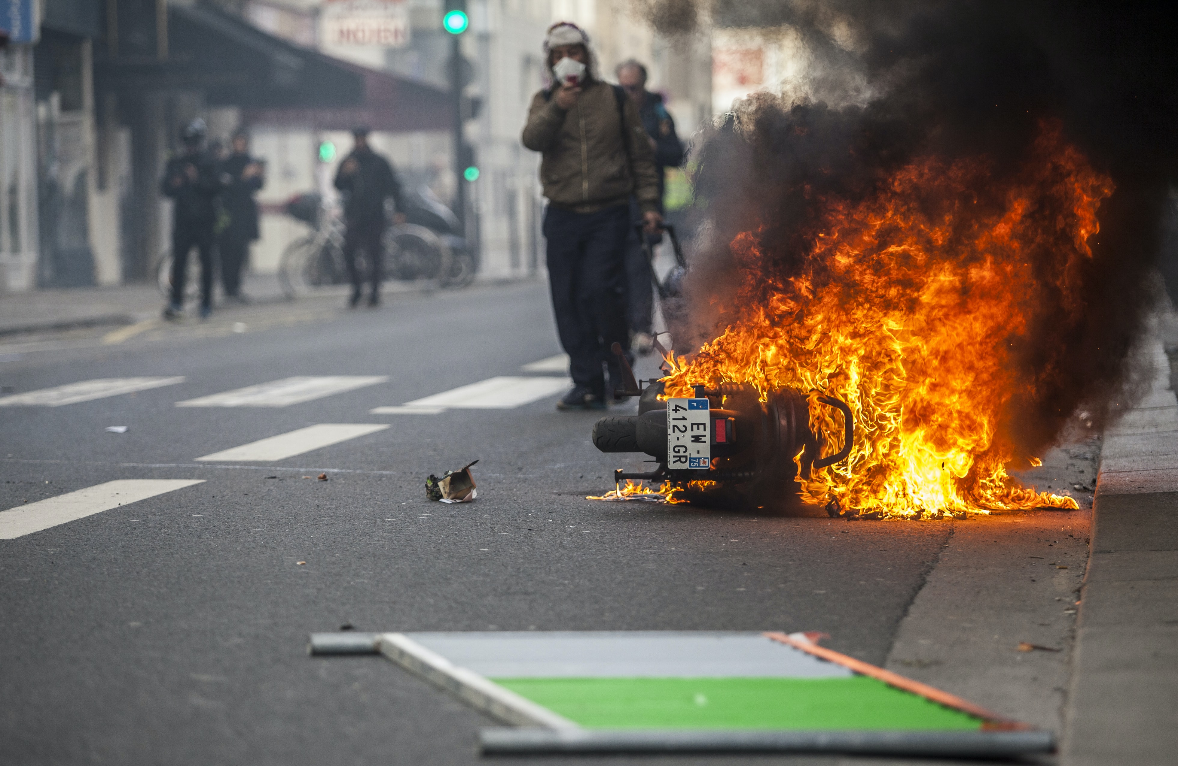 motorcycle burning in the middle of the road