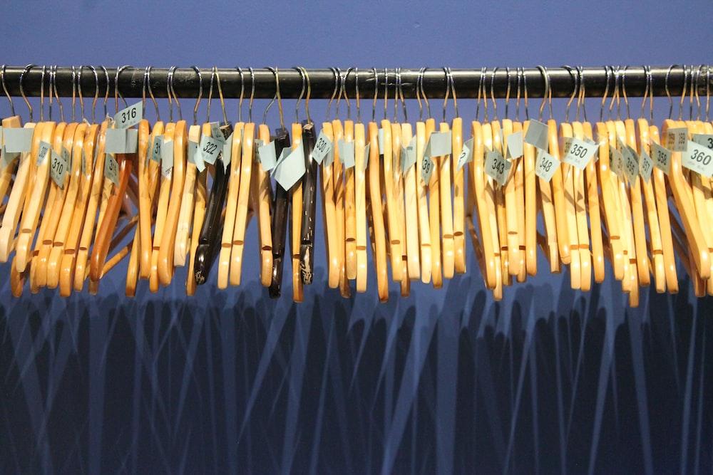 brown wooden clothes hanger
