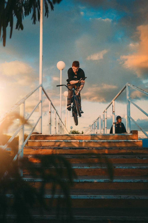man in black sweater riding bicycle during daytime