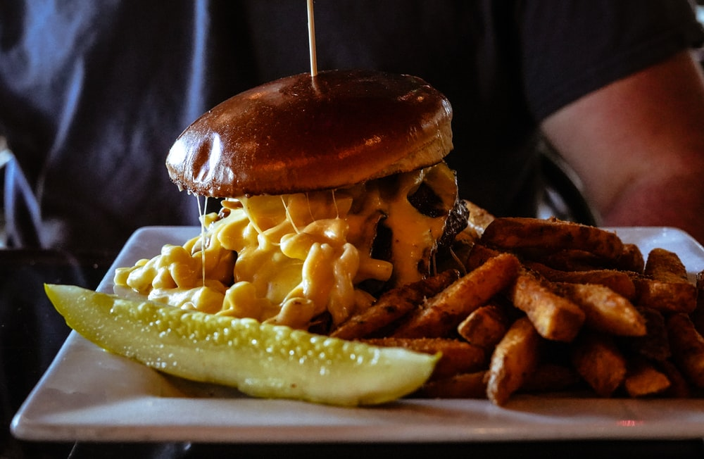 burger with cheese macaroni and fries