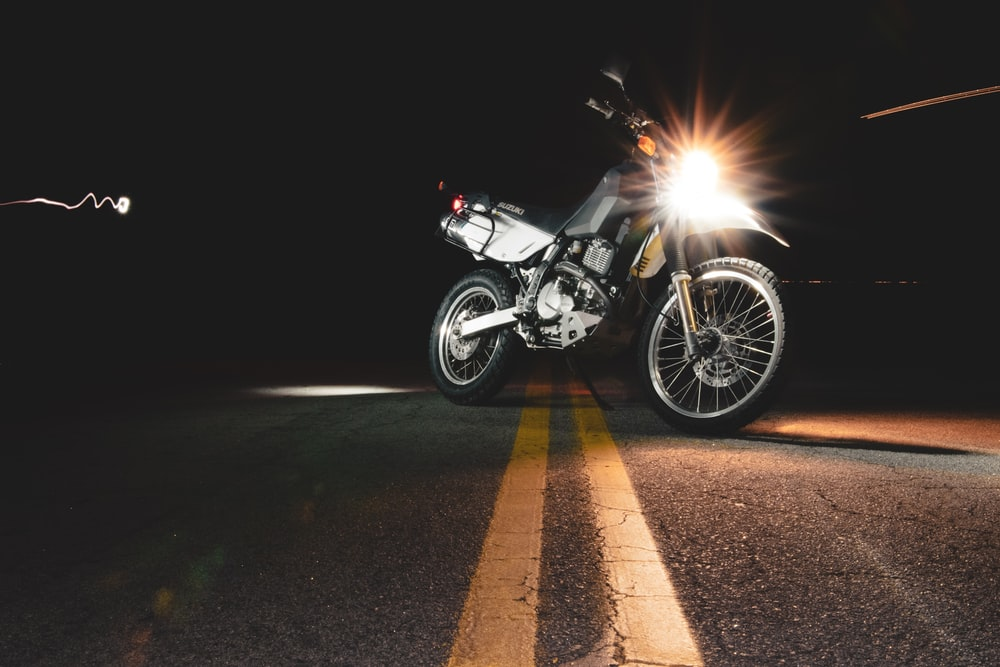 lighted headlight of parked motorcycle