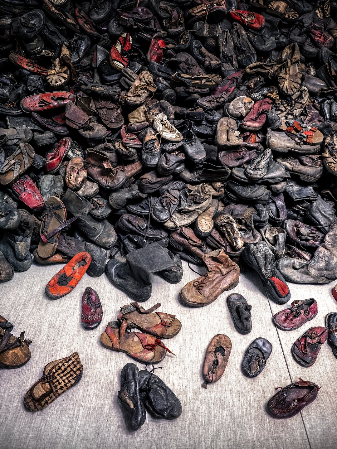 This image was captured at the Auschwitz concentration camp in Oświęcim, Poland. It shows part of a huge pile of children's shoes stolen by the Germans from Jews arriving at the concentration camp, which have been preserved as a museum exhibit.