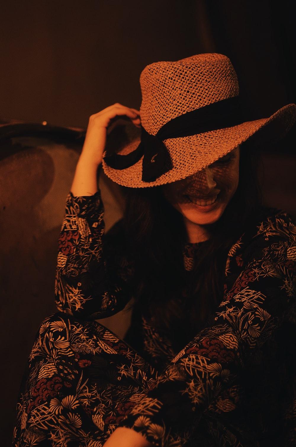 smiling woman wearing brown hat
