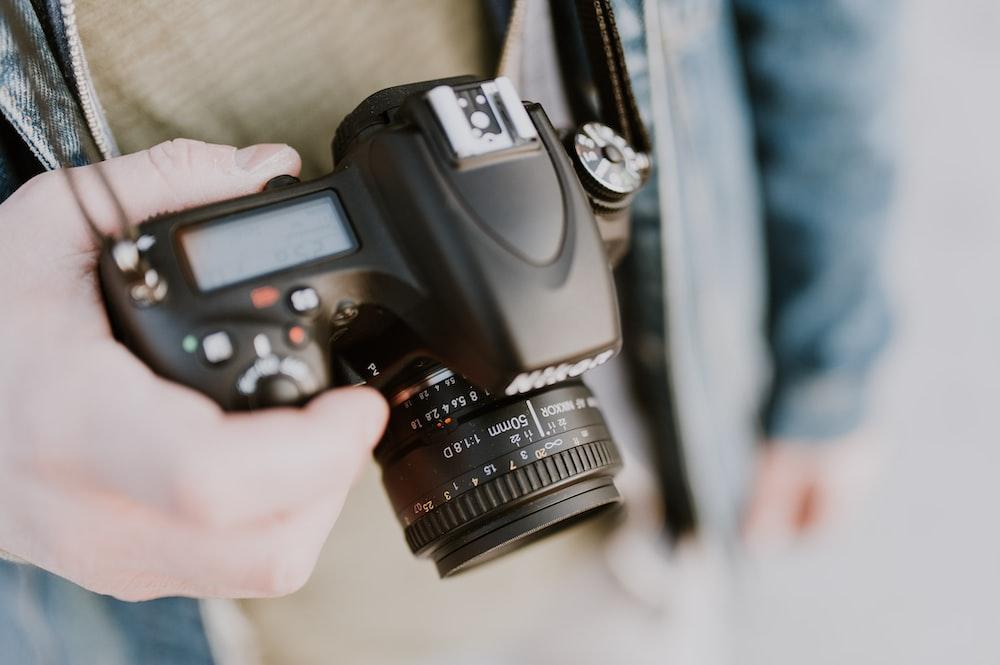 person holding Nikon bridge camera