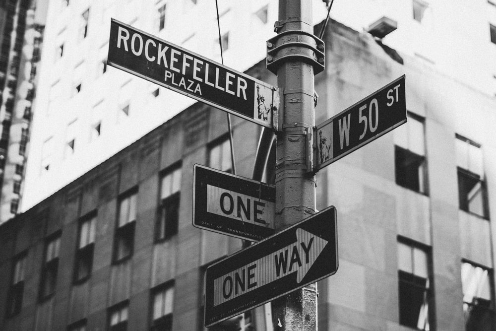 greyscale photo of street signage