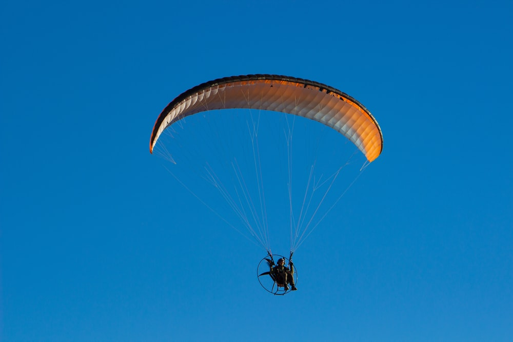 person riding on parachute