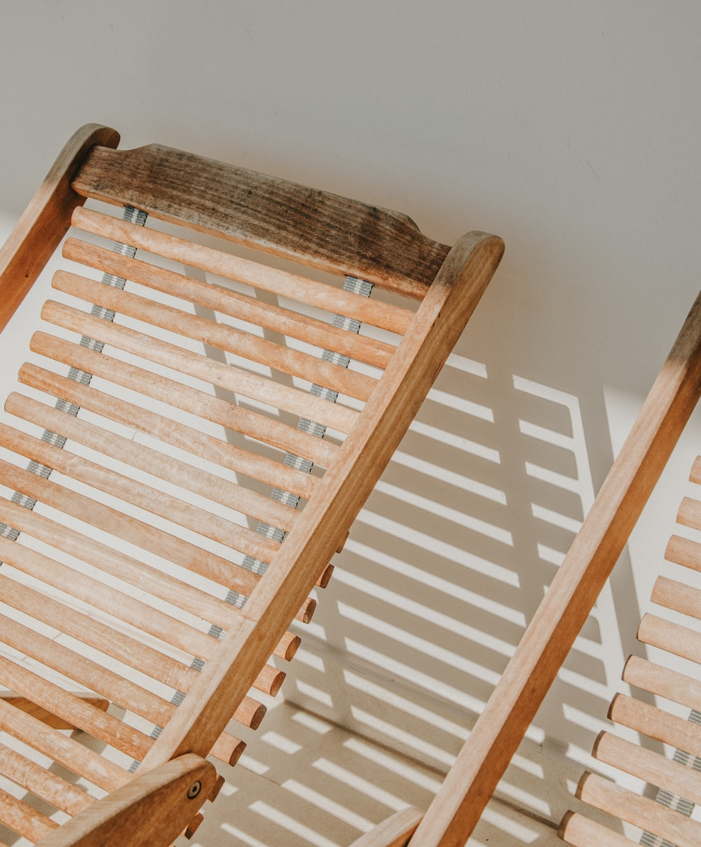 two vacant brown wooden loungers