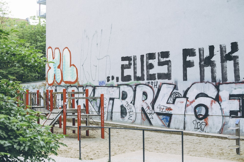 assorted graffiti on white wall