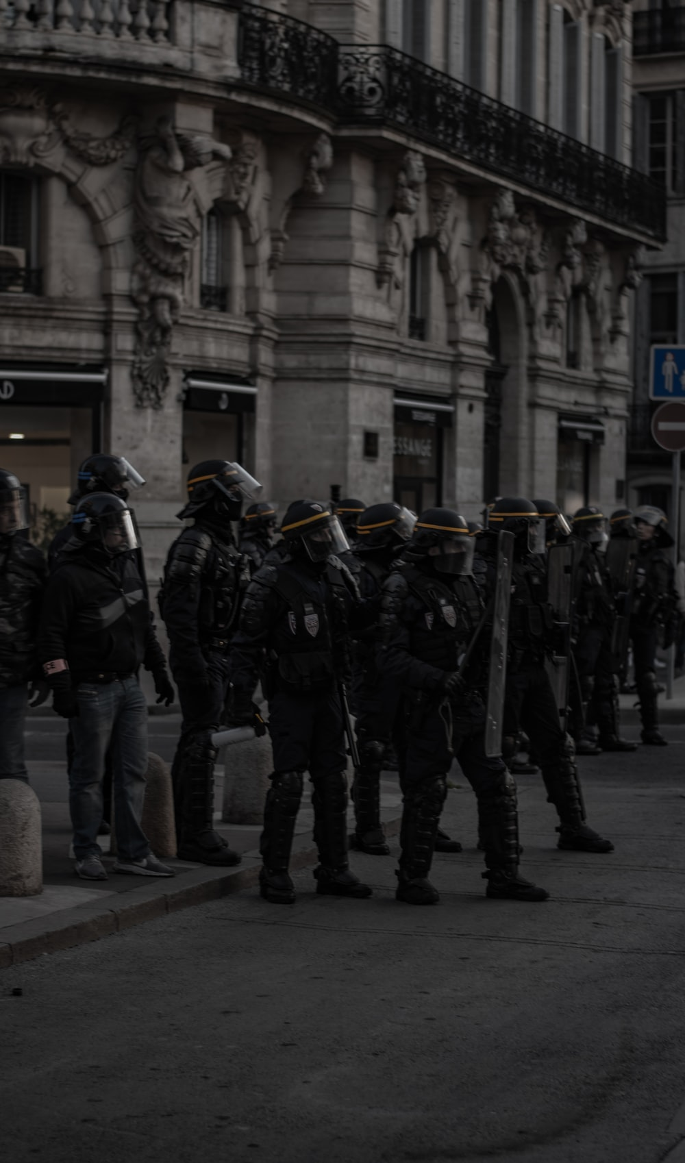 soldiers holding shields near building