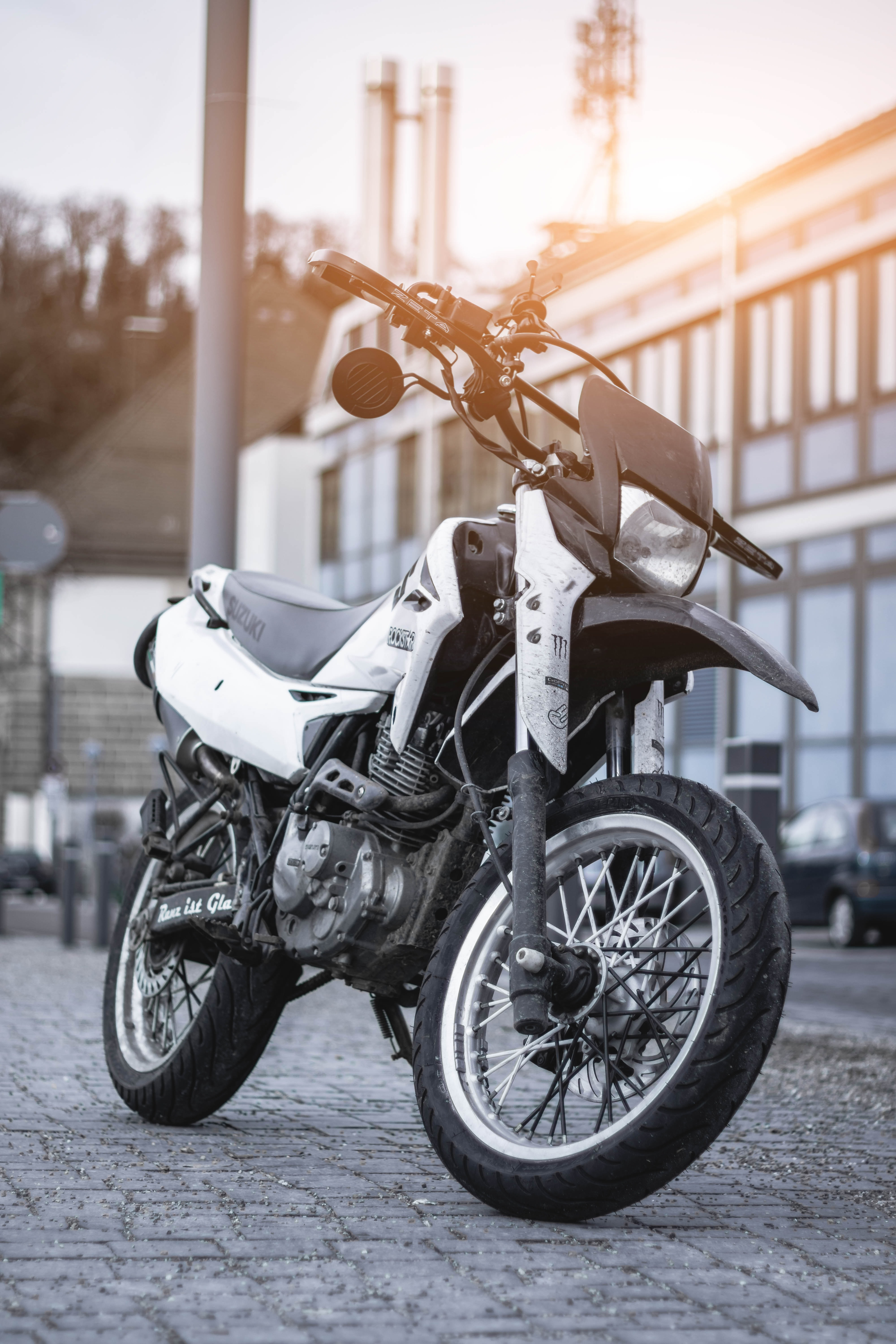 white and black motorcycle park during daytime