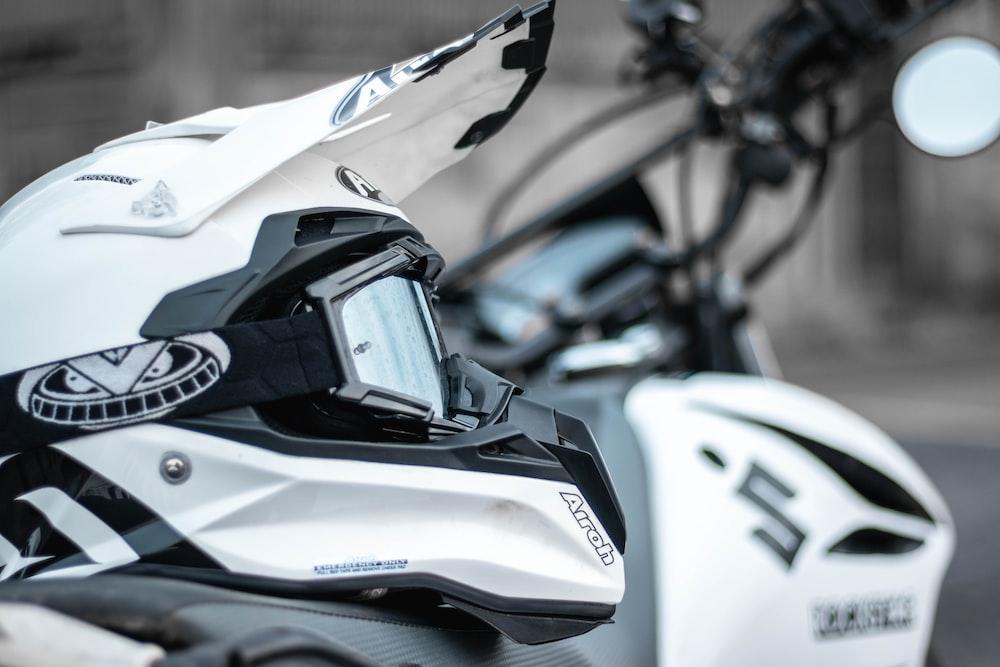person wearing white motocross helmet
