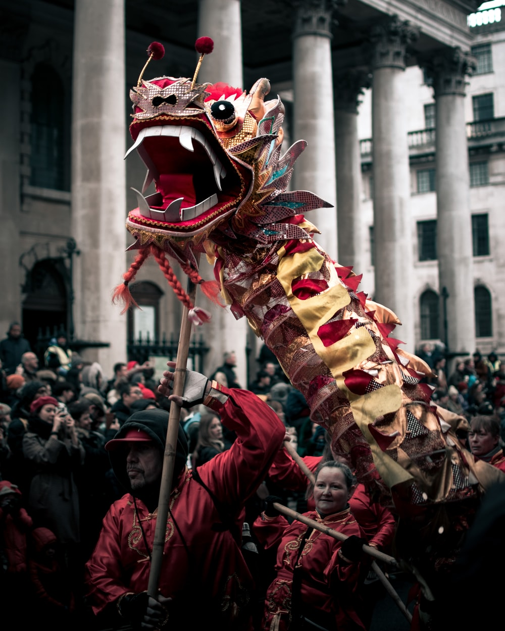 group of people performing lion dance
