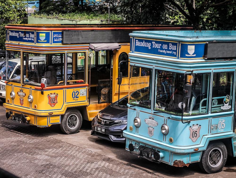 black vehicle in between busses