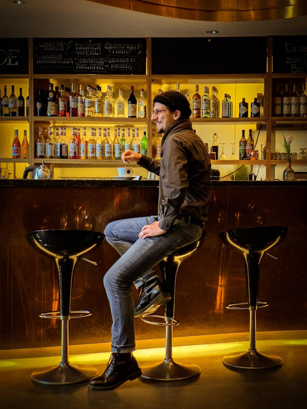 man sitting on hydraulic barstool