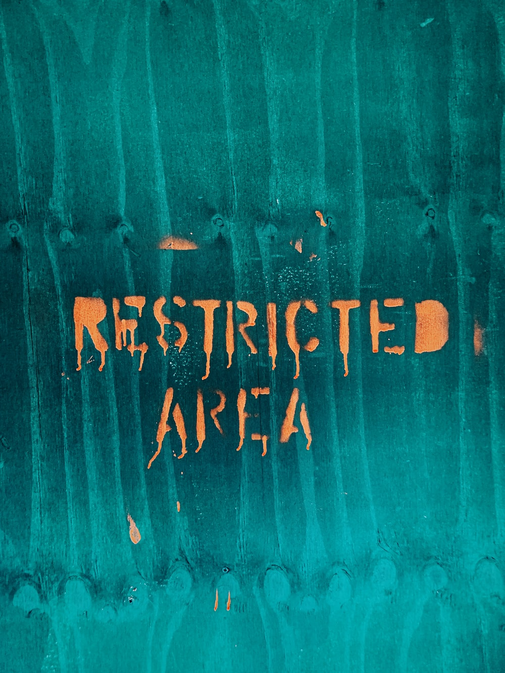 restricted area text with teal background