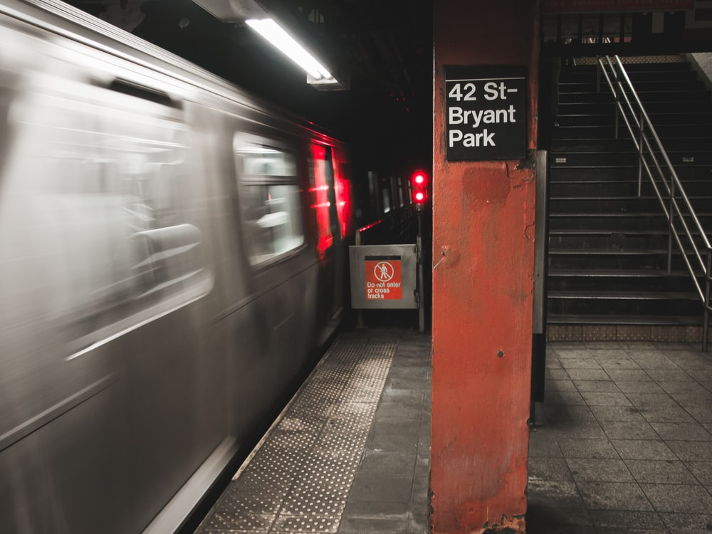 gray train time-lapse photography in tunnel