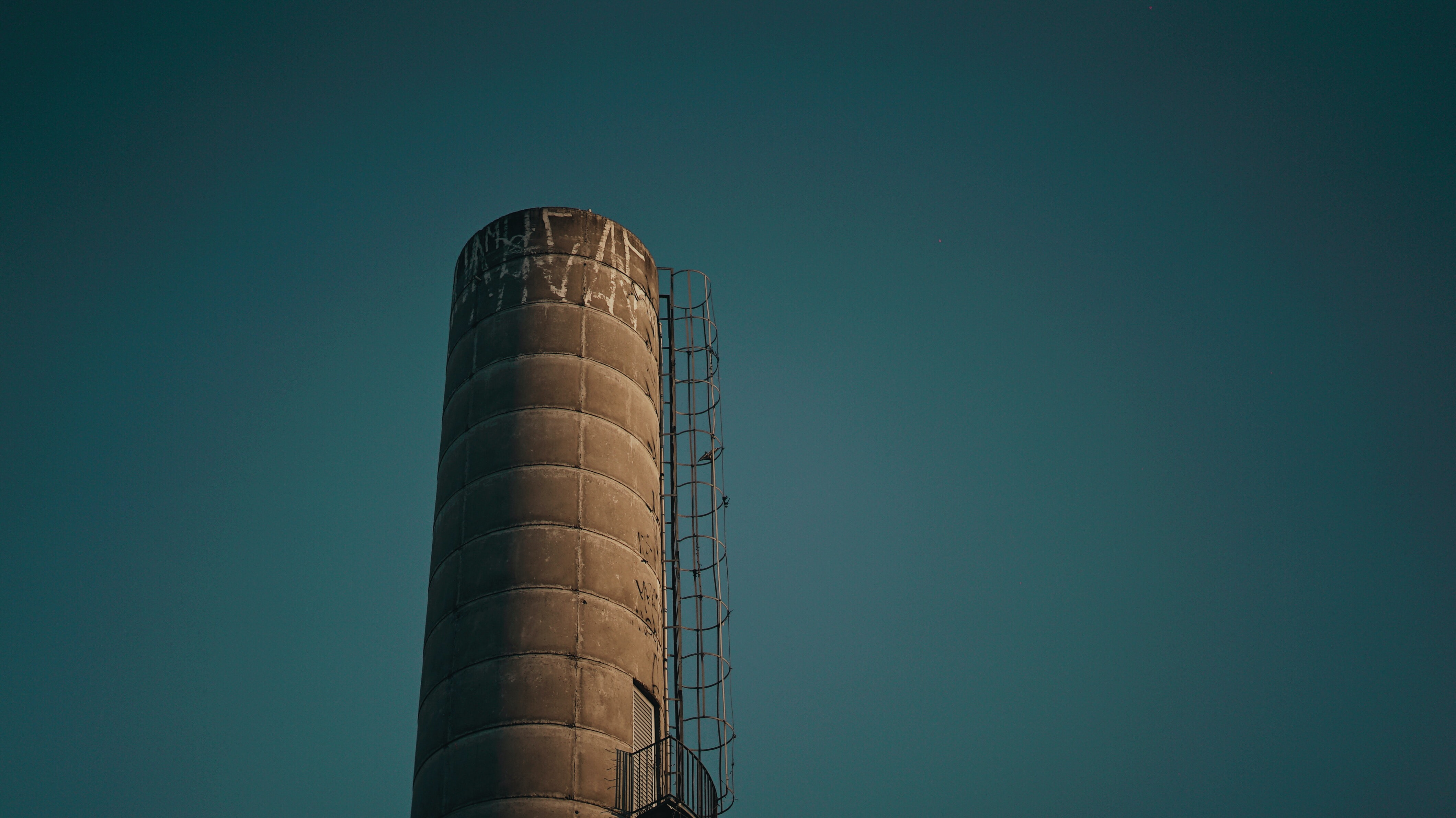 gray power plant with ladder close-up photo