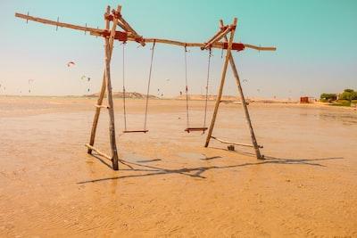 Dakhla brown wooden swing on sand