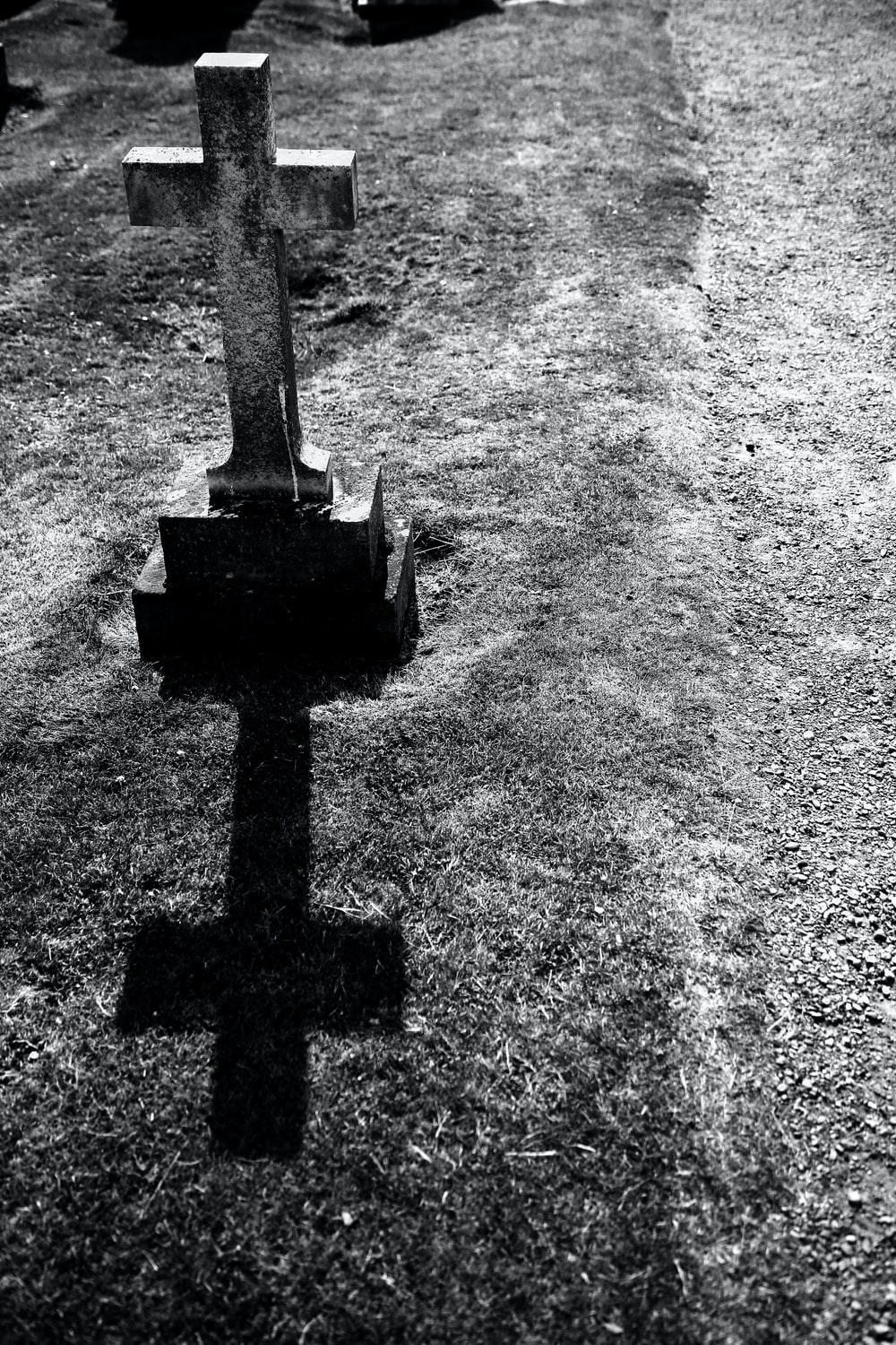 grayscale photography of gray tombstone