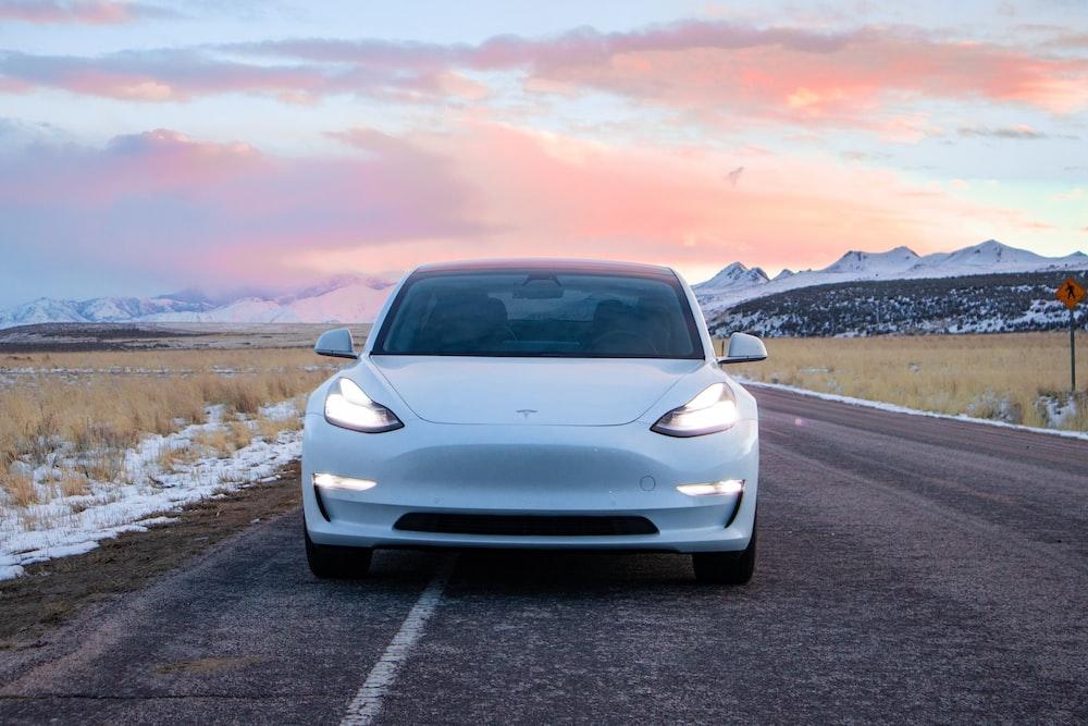 white car on asphalt road during daytime