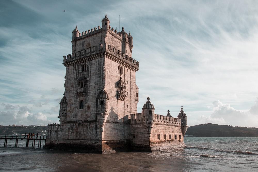 brown castle near sea