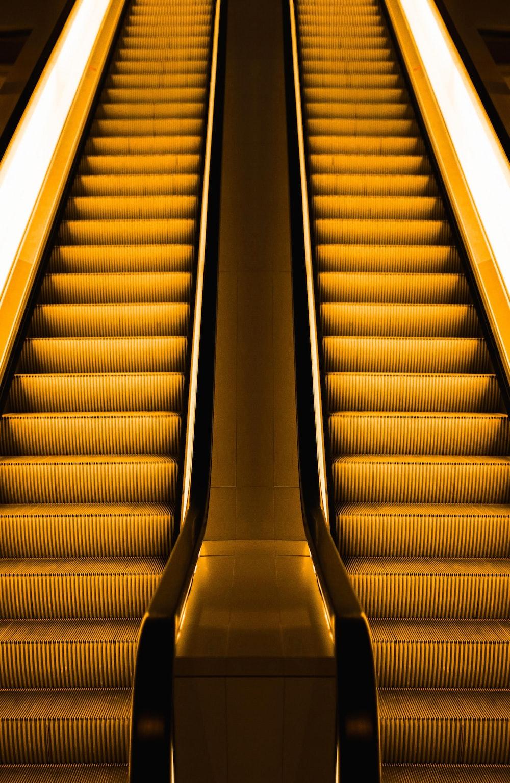 low-angle photography of two escalators