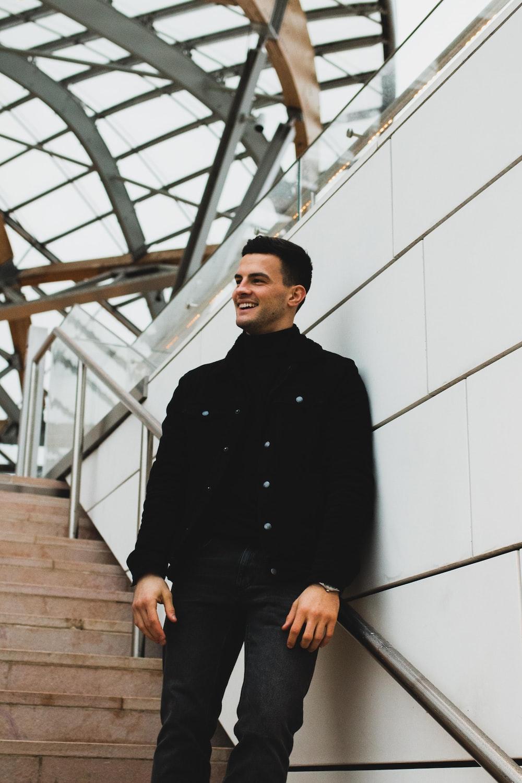 shallow focus photo of man wearing black turtleneck long-sleeved shirt