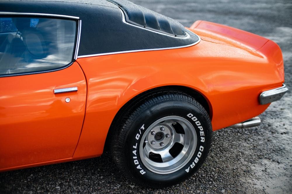 orange and black car in field