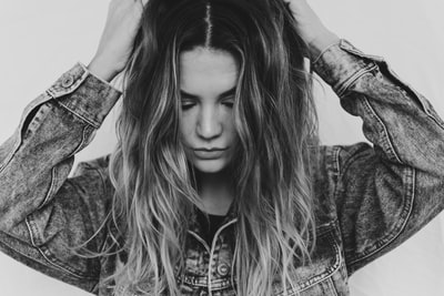 grayscale photography of woman wearing gray denim jacket