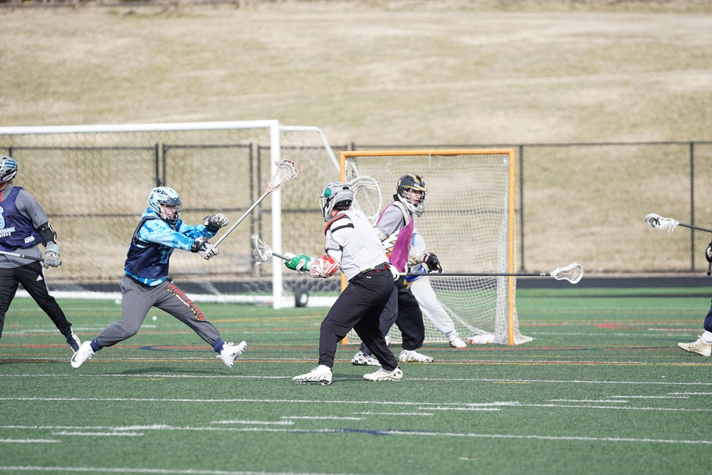 people playing lacrosse at the field