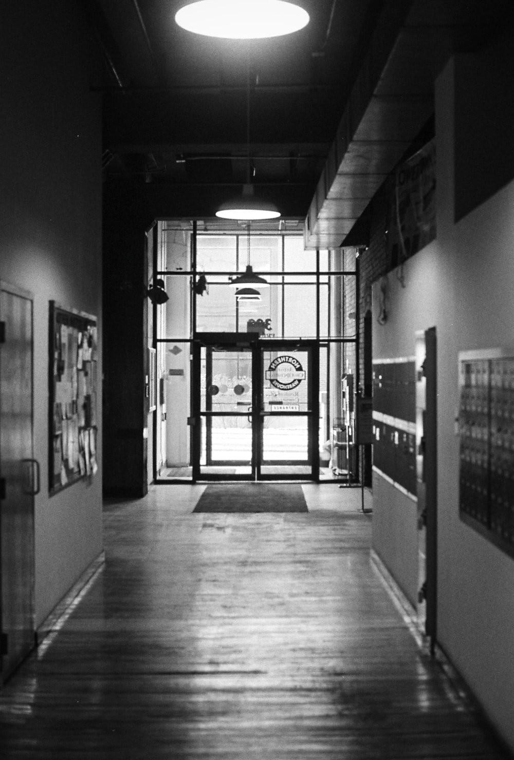 grayscale photography of empty hallway