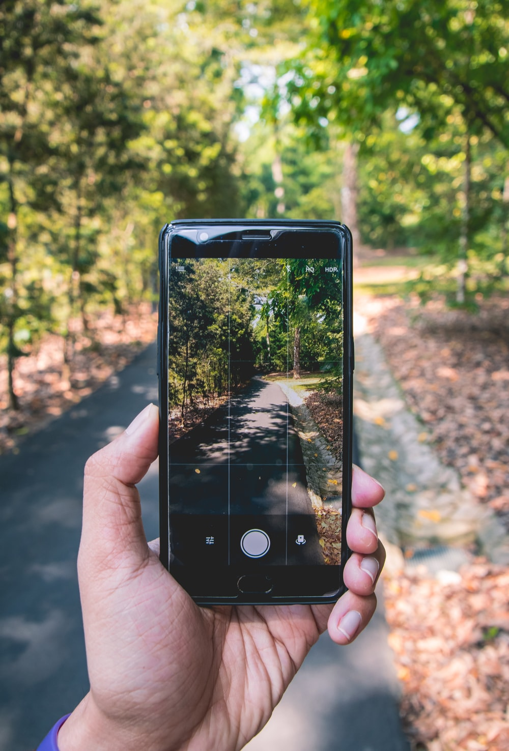 black smartphone on hand