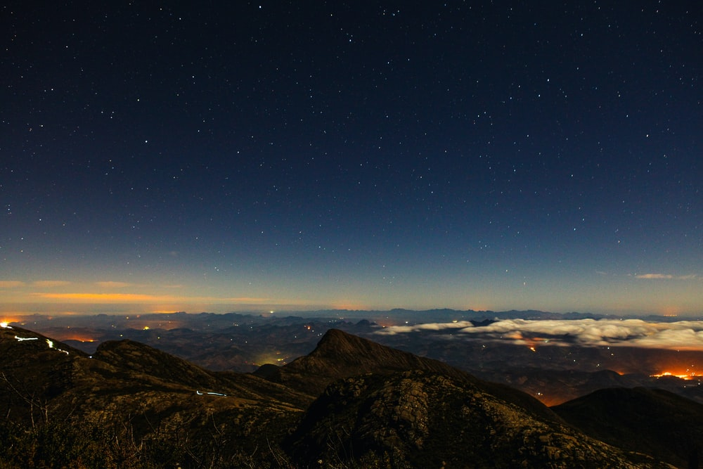 high-angle photography of brown mountains at night