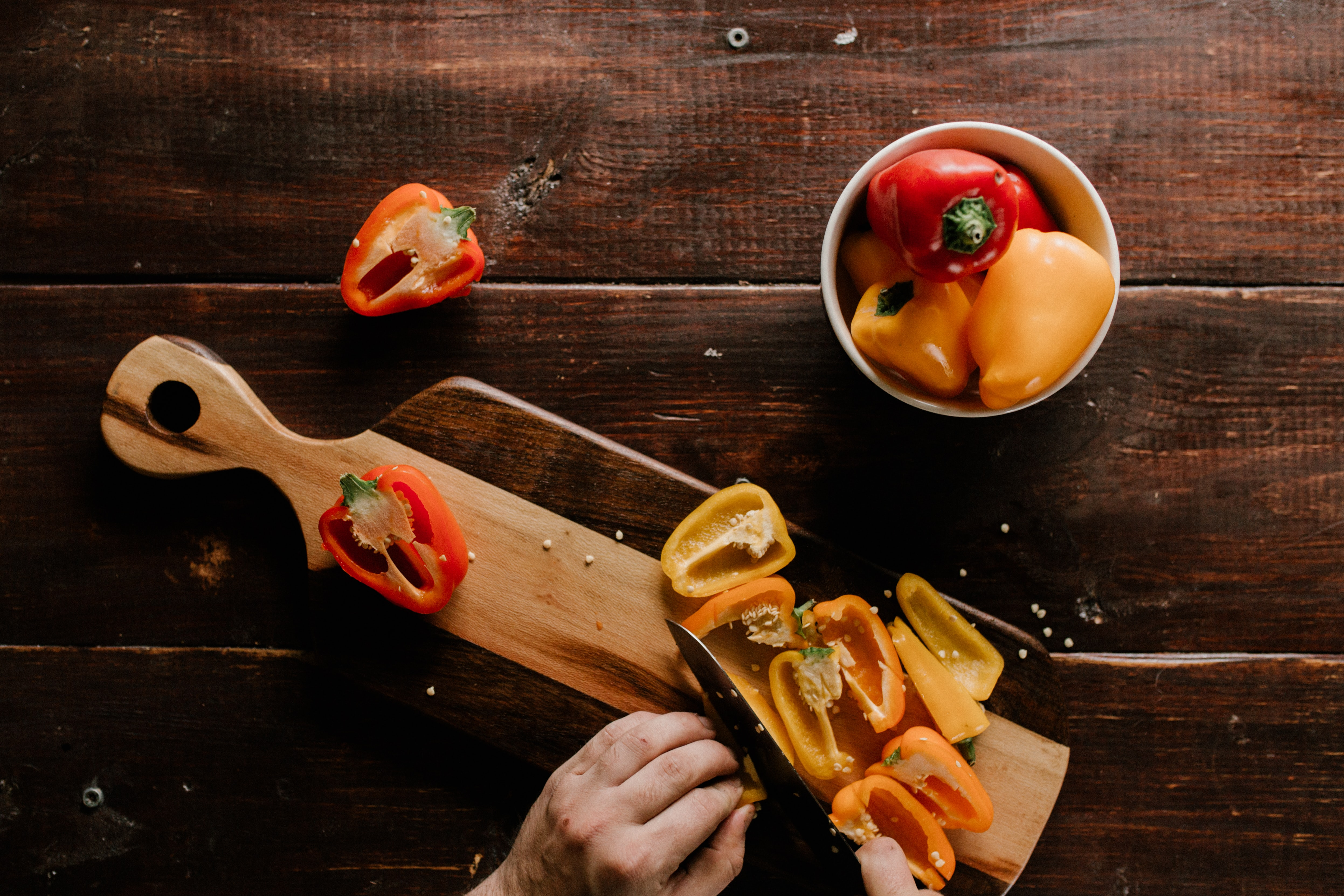 person slicing peppers