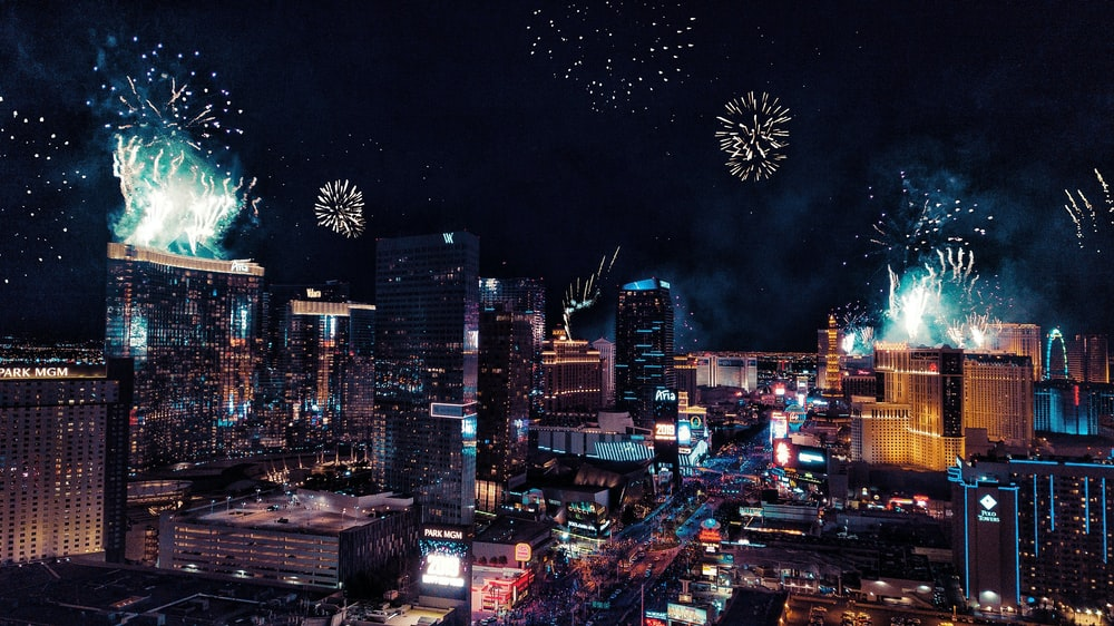 city with fireworks during night time
