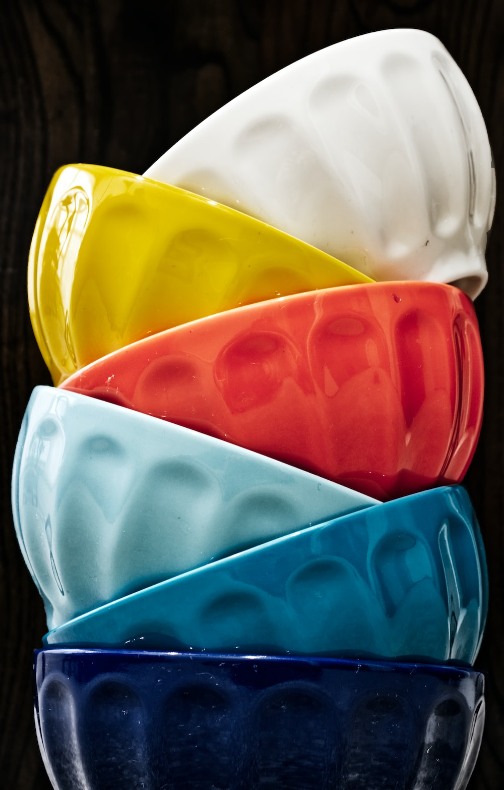 six assorted-colored bowls