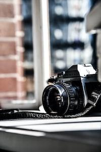 black and gray Pentax SLR camera