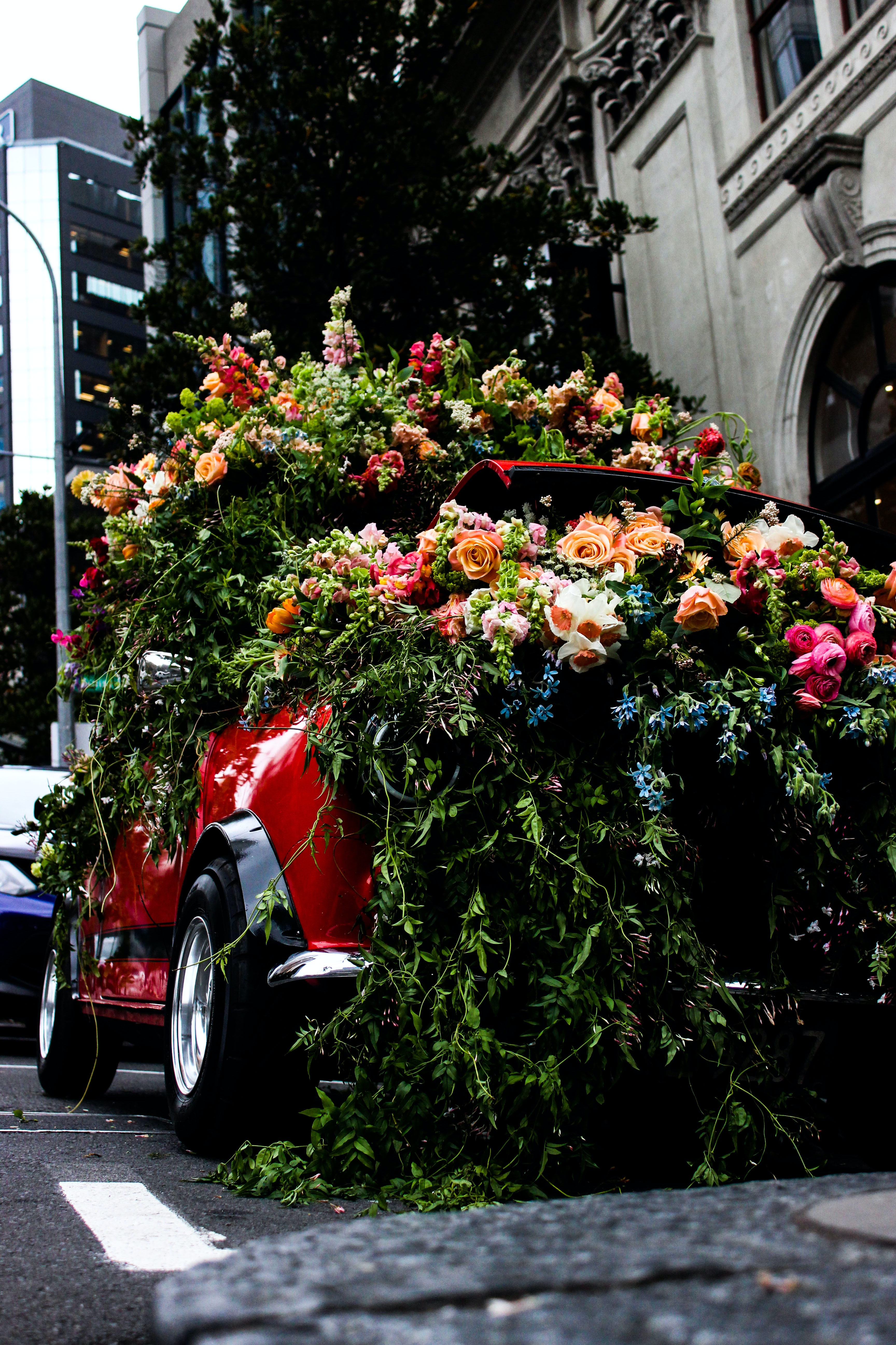 red vehicle covered with flowers