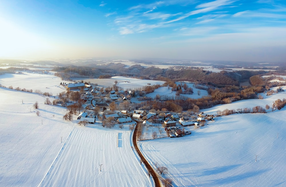 aerial photography of town covered with snow